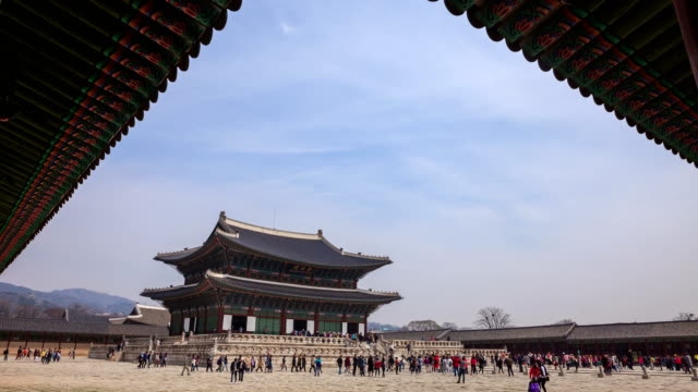 Tourists at Geunjeongjeon Hall (the Imperial Throne Hall) in Gyeongbokgung Palace (royal palace of the Joseon dynasty)