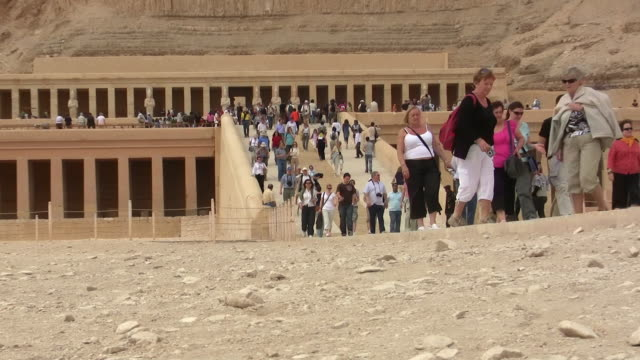 ZO, WS, Tourists at Hatshepsut's temple, Deir el-Bahri, Valley of the Kings, Egypt