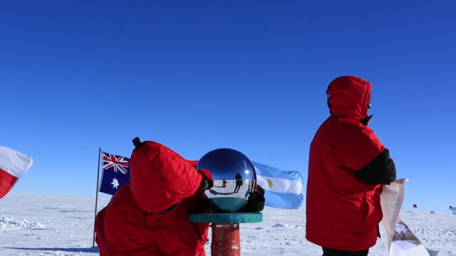tourists at magnetic south pole (unrecognizable) - south pole stock videos and b-roll footage