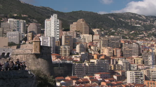 tourists at prince's palace of monaco observation point overlooking cityscape against mountain on sunny day - monte carlo, monaco - royal palace monaco stock videos and b-roll footage