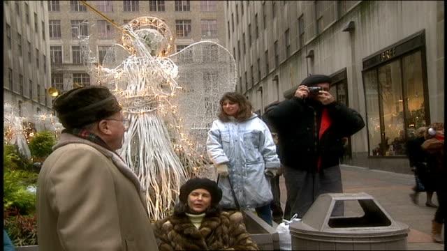 tourists at rockefeller center - rockefeller center christmas tree stock videos & royalty-free footage