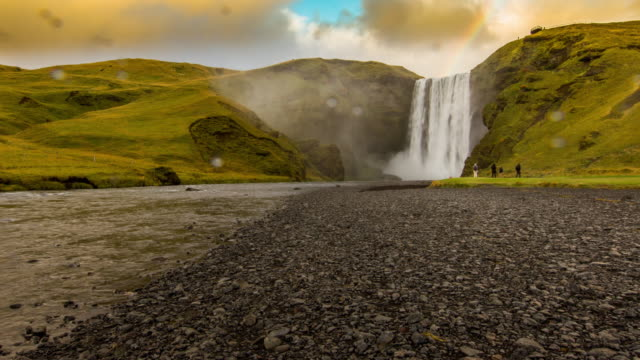 T/L Tourists at Skogafoss waterfall in Iceland