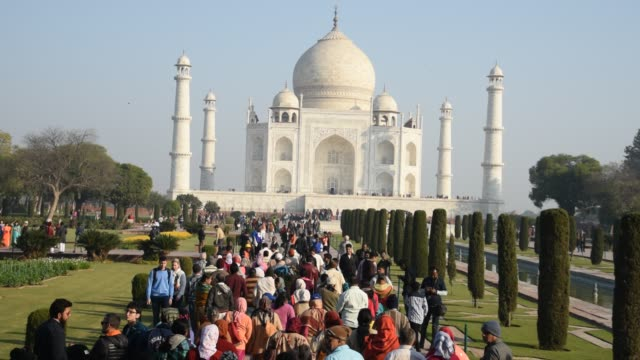 tourists at taj mahal, unesco world heritage site, agra, india. - mughal empire stock videos and b-roll footage