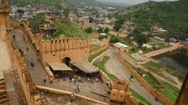 tourists at the amer fort, jaipur,  unesco world heritage site. india. - indigenous culture stock videos & royalty-free footage