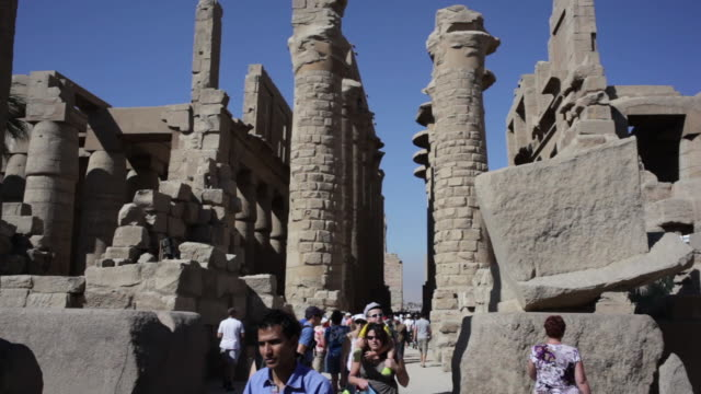 tourists at the karnak temple complex - temples of karnak stock videos and b-roll footage