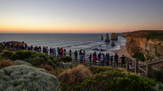 tourists at twelve apostles and great ocean road at sunset / melbourne, victoria, australia - great ocean road stock videos & royalty-free footage