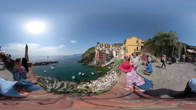 360 VR / Tourists at view point of Riomaggiore over the mediterranean sea