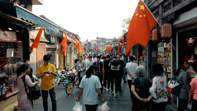 tourists at yandai inclining street nearby houhai lakes area ,beijing, china - scratched stock videos & royalty-free footage
