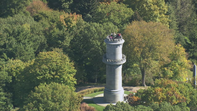 aerial tourists atop mount auburn tower in cemetery parkland, city suburbs and harbor beyond / watertown, massachusetts, united states - massachusetts stock videos & royalty-free footage