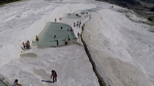tourists bathing and relaxing in the calcium carbonate pools of pamukkale in the aegean region turkey on september 13 2016 pamukkale meaning 'cotton... - calcium carbonate stock videos and b-roll footage