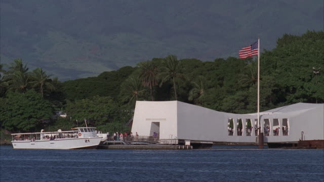 MS, Tourists boarding on tour boat at USS Arizona Memorial, Pearl Harbor, Hawaii, USA