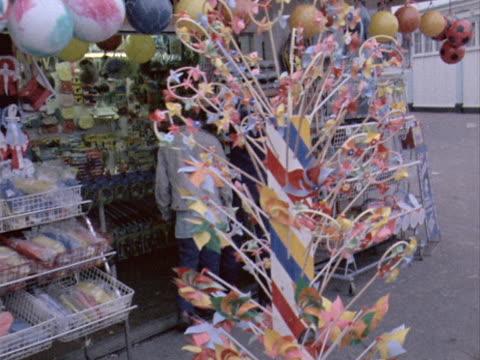 tourists browse the souvenir shops on southend pier - pier stock videos & royalty-free footage