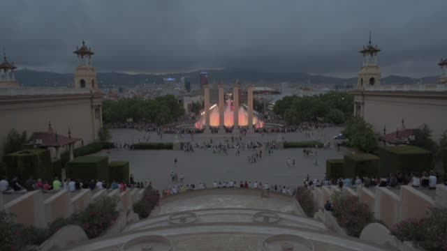 tourists by fountain at famous landmark in city against cloudy sky - barcelona, spain - clergy stock videos & royalty-free footage