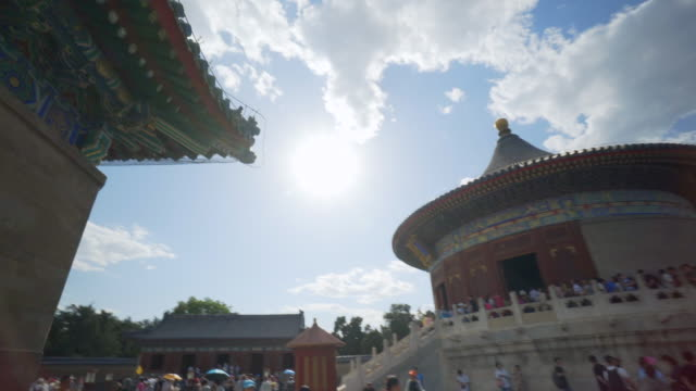 tourists by traditional building at imperial vault of heaven - beijing, china - himmelstempel stock-videos und b-roll-filmmaterial