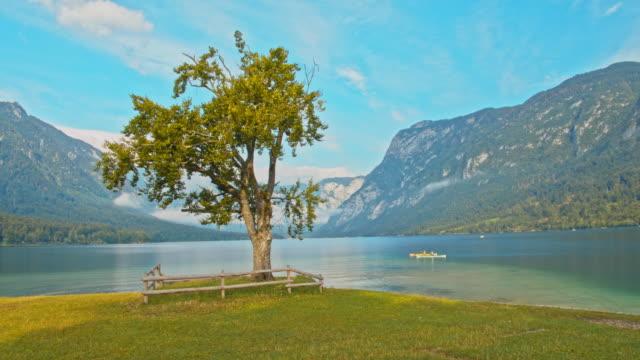 slo mo tourists canoeing on the lake - slovenia stock videos & royalty-free footage