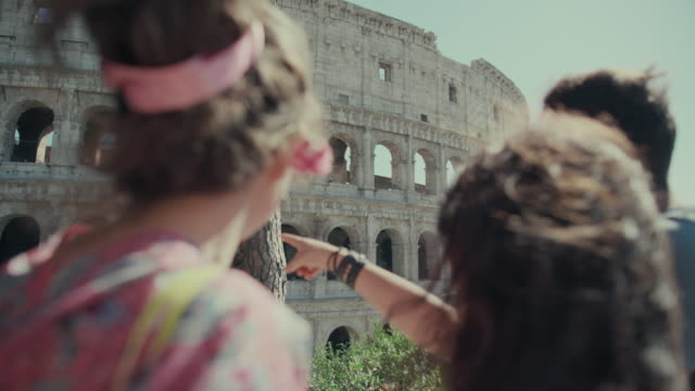 Tourists checking monuments of Rome on mobile phone