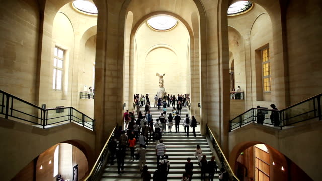 tourists climb stairs to view the statue of nike. - louvre stock videos and b-roll footage