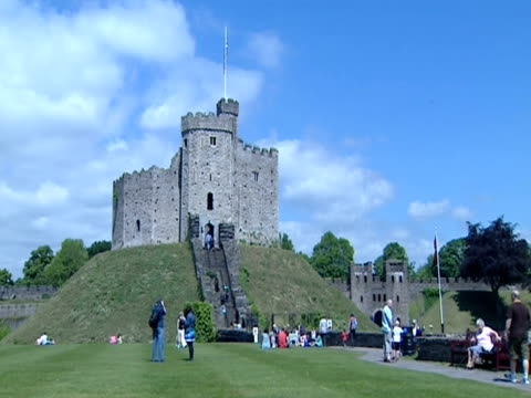 tourists climb the norman keep in the grounds of cardiff castle. - cardiff wales stock videos & royalty-free footage