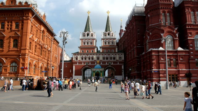 Tourists cross in front of the State Historical Museum near the Red Square in Moscow, Russia.