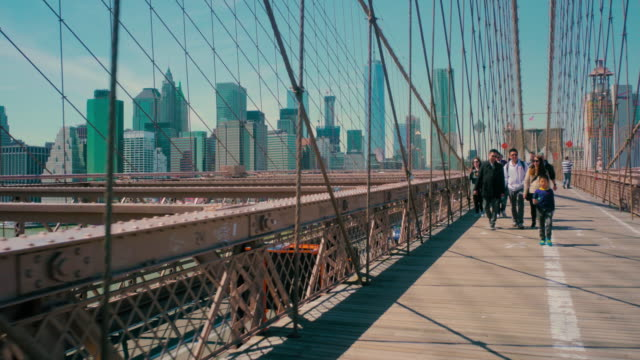 Tourists crossing Brooklyn Bridge in New York