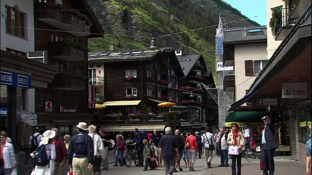 tourists crowd the village of zermatt, switzerland. - tourist stock-videos und b-roll-filmmaterial