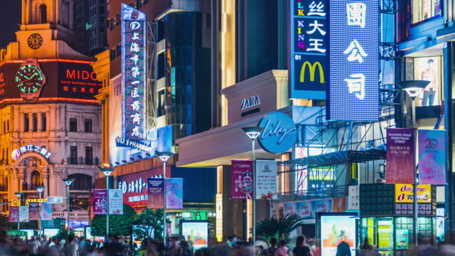 tourists crowds of people walking shopping on nanjing road pedestrian street on the night shanghai street nght timelapse - chinese script stock videos & royalty-free footage