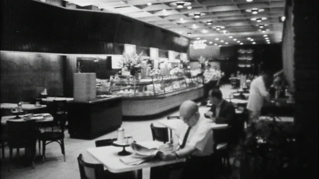 Tourists dine at inexpensive restaurants in New York City, from Automats to cafeterias to drugstore lunch counters.