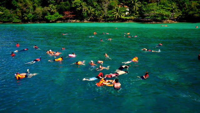 koh chang, thailand - march 4, 2018: tourists diving and swimming in gulf of thailand sea, koh chang a popular tourist many visitors every year. - koh chang stock videos and b-roll footage