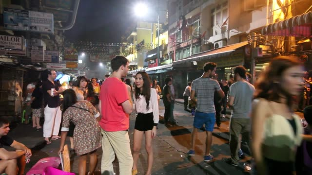 Tourists drink and smoke at outdoor bars on Khao San Road in Bangkok
