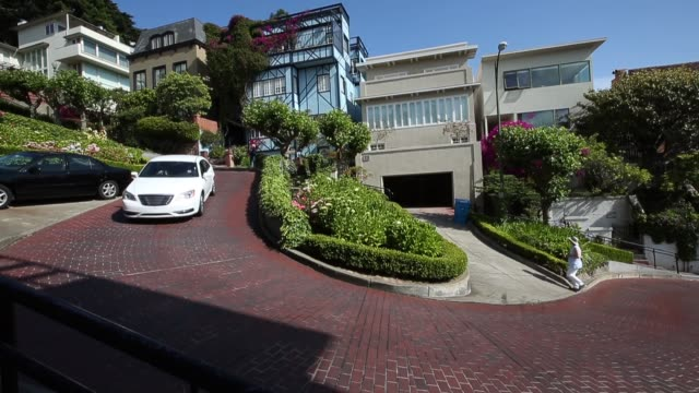 ws tourists drive down lombard street on may 20 2014 in san francisco california the san francisco municipal transportation agency board of directors... - lombard street san francisco stock videos & royalty-free footage