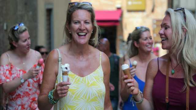 tourists eating ice cream - italian culture stock videos & royalty-free footage