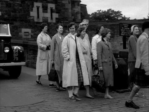 Tourists enjoy a tour of Edinburgh Castle