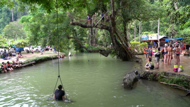 Tourists enjoy at Blue Lagoon in vangvieng in Laos