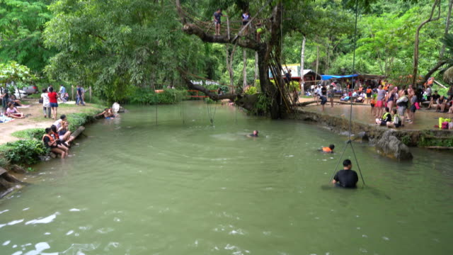 Tourists enjoy at Blue Lagoon in vangvieng, Laos