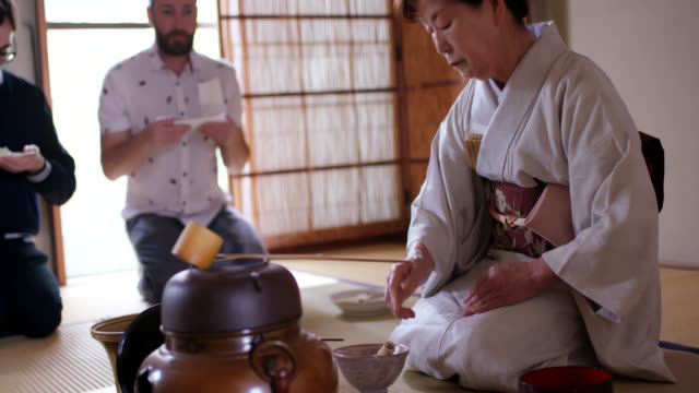tourists enjoying a traditional japanese tea ceremony - tatami mat stock videos and b-roll footage