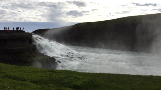 Tourists enjoying the Gullfoss waterfall in Iceland