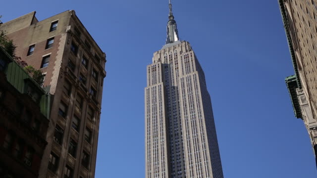 tourists enter the empire state building, and views of the building in new york, u.s. on friday, may 25, 2018. - empire state building stock videos & royalty-free footage