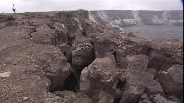 tourists examine kilauea crater in volcanoes national park. - pacific islands stock videos & royalty-free footage