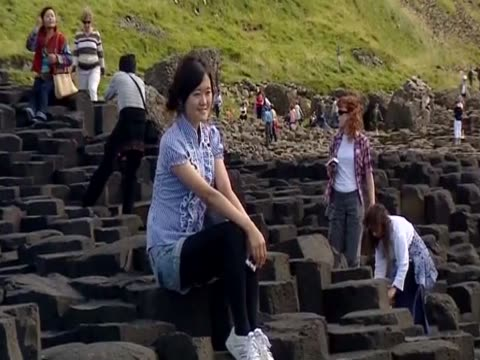 tourists explore giant causeway - natural column stock videos and b-roll footage