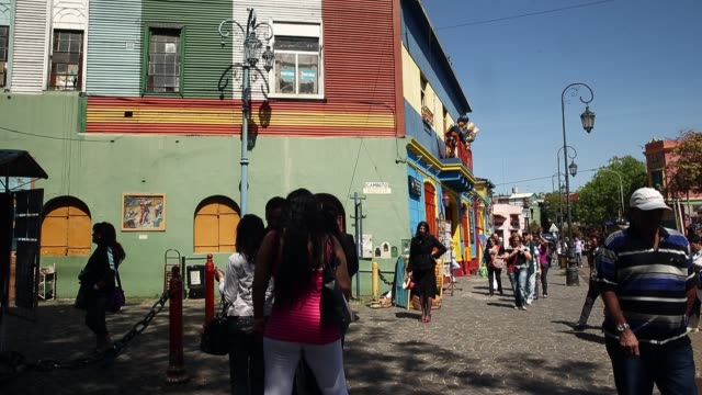 tourists explore la boca on september 30 2014 in buenos aires argentina - buenos aires stock videos & royalty-free footage
