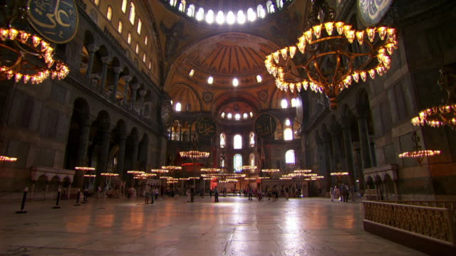 tourists explore the interior of the hagia sophia in istanbul. - hagia sophia istanbul stock videos & royalty-free footage