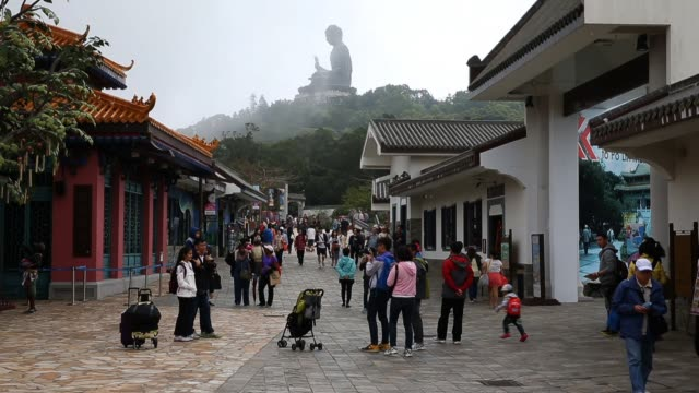 vídeos y material grabado en eventos de stock de tourists explore the po lin monastery and tian tan buddha attractions at lantau island in hong kong on march 21 2013 in hong kong hong kong the... - lantau