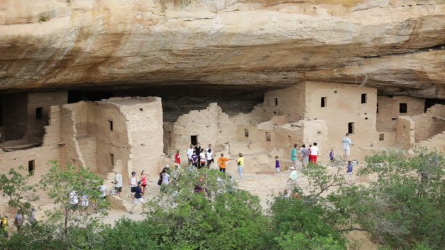 LA HA Tourists explore the ruins of Spruce Tree House / Mesa Verde National Park, Colorado