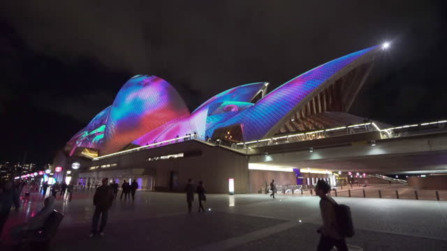 tourists exploring psychedelic pattern on sydney opera house - oceania stock videos & royalty-free footage