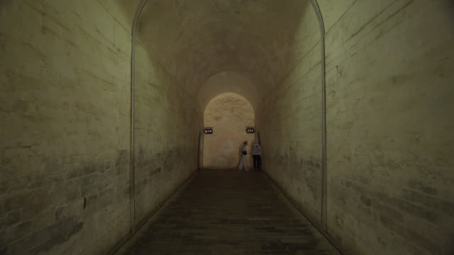 tourists exploring tunnel at historic minglou tower - beijing, china - ming tombs stock videos and b-roll footage