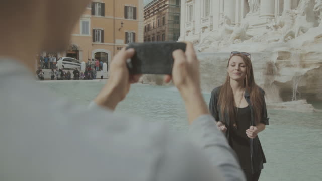 tourists filming coin throwing in trevi fountain - fountain stock videos & royalty-free footage