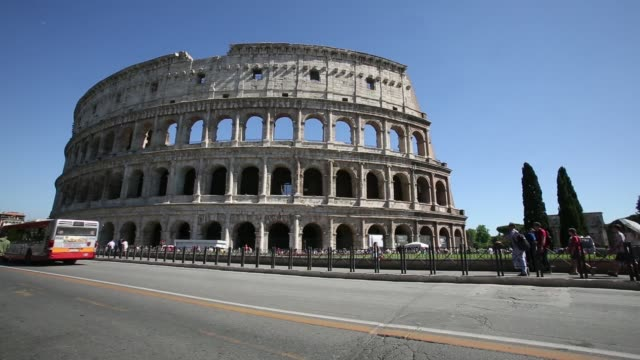 stockvideo's en b-roll-footage met tourists flock around the colosseum in rome italy on friday may 29 2015 - colosseum