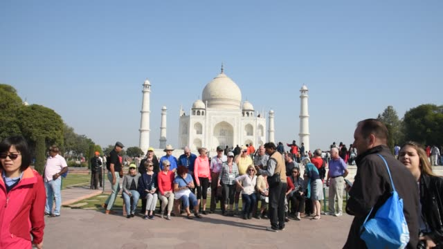 tourists from around the world visit to the taj mahal, agra, india. - mughal empire stock videos and b-roll footage