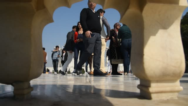 tourists from around the world visit to the taj mahal, agra, india. - agra stock videos and b-roll footage