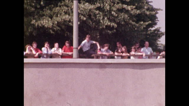 tourists from west berlin look over wall to the east berlin side; 1970 - germany stock videos & royalty-free footage